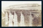 Pont de Grandfey (en fer, avant le betonnage) avec deux locomotives tirant 15 wagons.. GARCIN, A. (photographe):