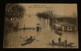 Carte postale ancienne : Crue de la Seine - Paris, porte de la Gare et Quai d'Ivry. Collectif