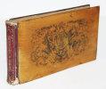 Souvenirs de Fontainebleau. Recueil de 29 lithographies dont 2 repliées dit «album genévrier» figurant le château de Fontainebleau et les plus beaux ...