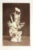 Photographie anonyme (circa 1860-1880) d'un faune en bronze ancien, barbu, fourchu, cornu et en érection, buvant à une coupe..