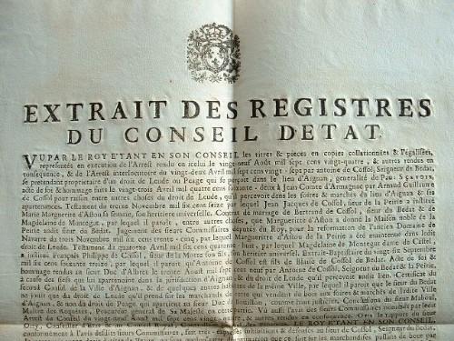Le roi interdit tout droit de péage à Aignan (Gers)..