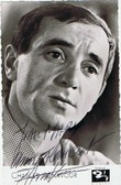 Carte postale dédicacée et signée par Charles Aznavour. . ( Chanson Française ) - Charles Aznavour.
